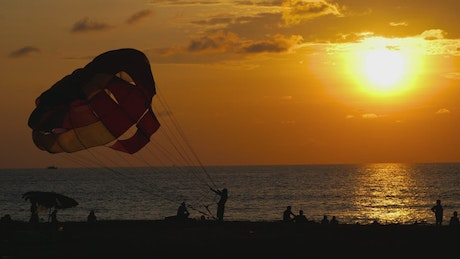Parachute and sunset at the beach