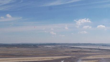 Parachutes landing in the desert