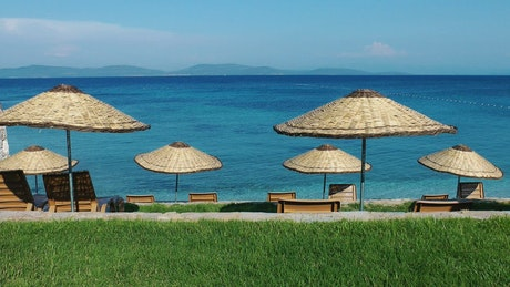Paradise beach with lounge chairs and umbrellas