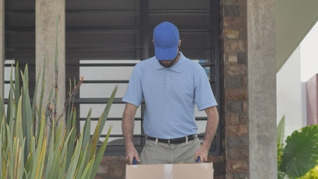 Parcel clerk with a package on a dolly