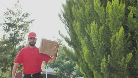 Parcel delivery man making a confident gesture