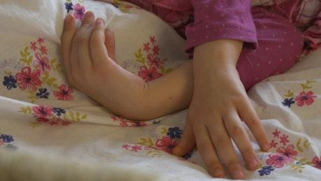 Parent caressing girl hands