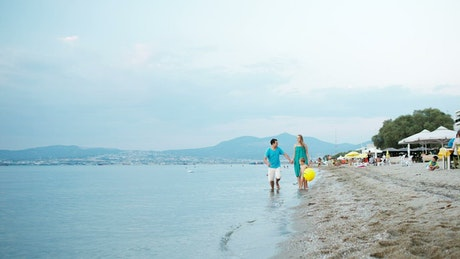 Parents running along the coast