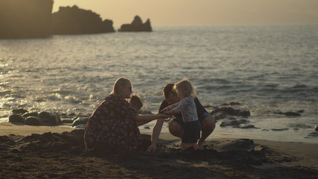Parents with two young children at the beach