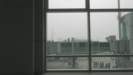 Passenger plane attached to a bridge