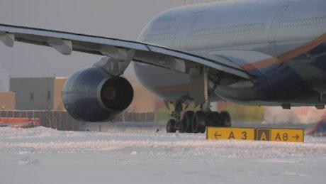 Passenger plane on a snowy runway