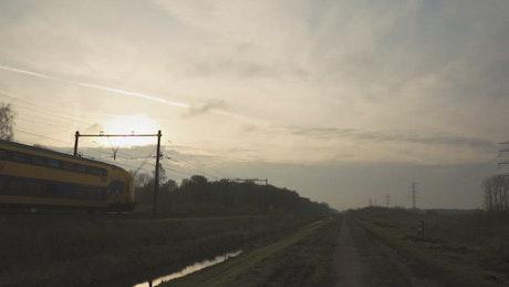 Passenger train at sunset