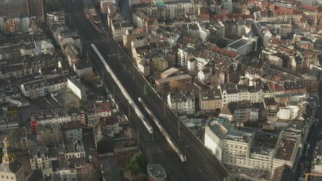 Passenger trains in the middle of a European city
