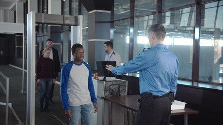 Passengers going through airport security