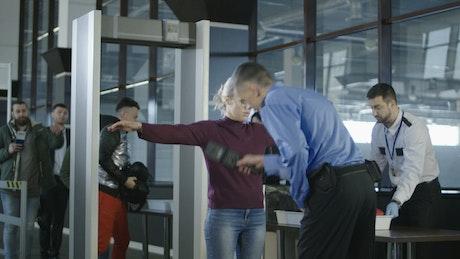 Passengers going through examination at airport