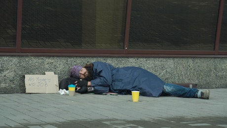 Passerby giving money to homeless