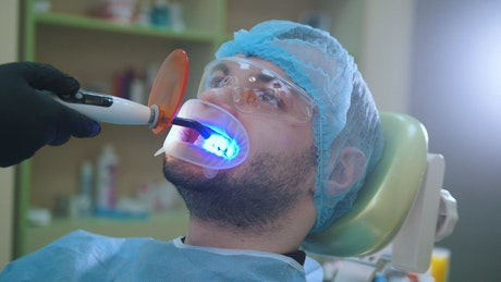Patient during a dental whitening session