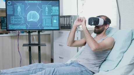 Patient in futuristic hospital uses VR to look at brain