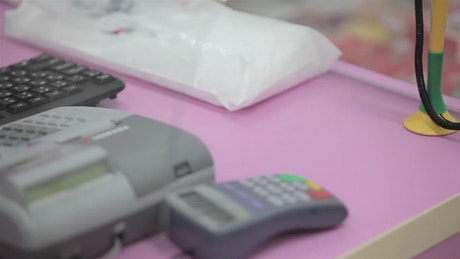 Paying with cash for drug at pharmacy counter