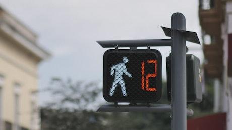 Pedestrian traffic light with a timer reaching zero