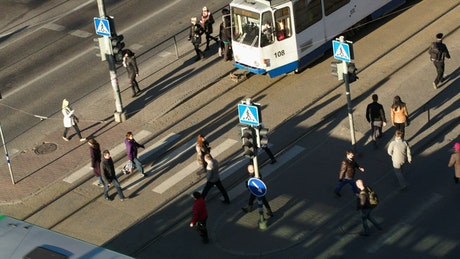 Pedestrians walking by a tram