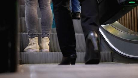 People boarding the escalator