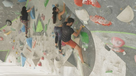 People climbing on a mountaineering wall