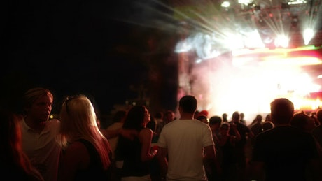 People dancing at a music festival