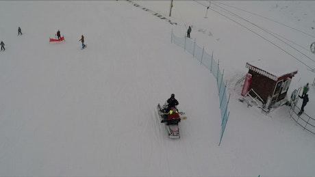 People enjoying a day at a ski resort