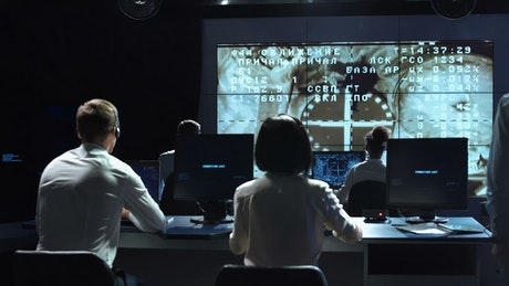 People on a space mission control celebrating