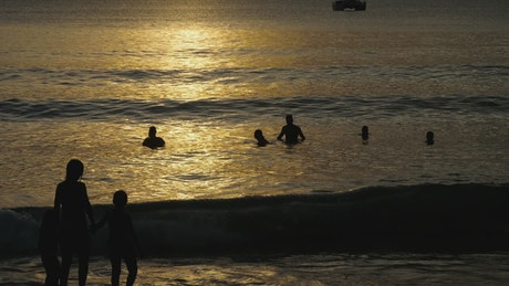 People silhouettes at the beach