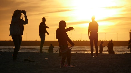 People silhouettes in the sunset