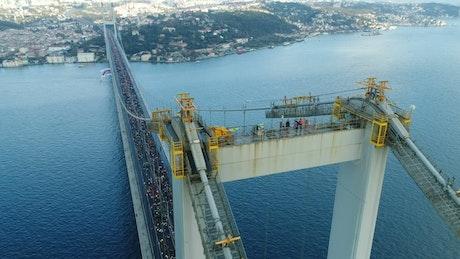 People standing on top of a bridge