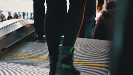 People taking the escalator down