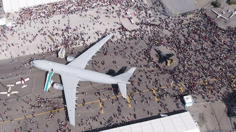 People viewing military aircraft