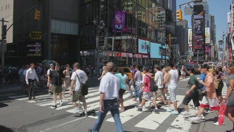 People walking across the road
