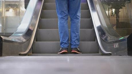 People walking into the escalator