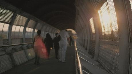 People walking on a footbridge