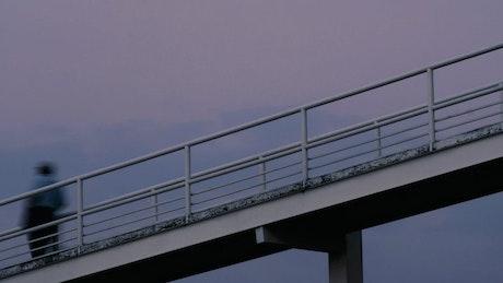 People walking on a footbridge timelapse