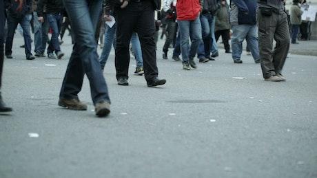 People walking slowly across town