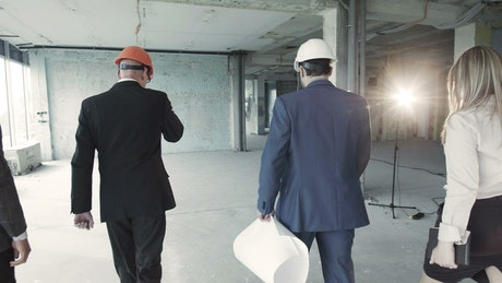 People walking through the construction site