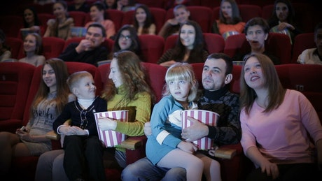 People watching a movie at the cinema