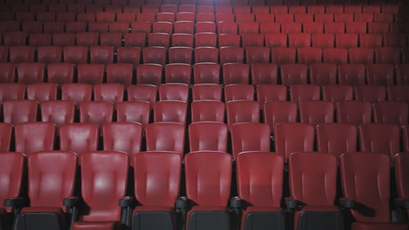People with masks sitting apart in a movie theater