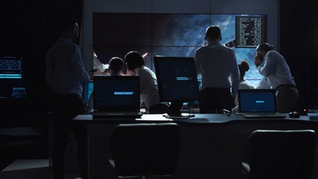 People working in space mission control center