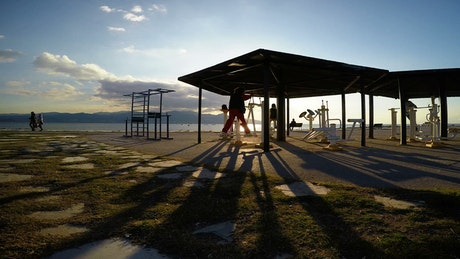 People working out on the beach at an outdoor gym