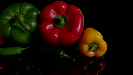 Peppers against a dark table