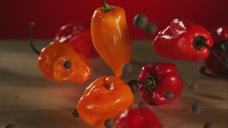Peppers falling and bouncing into the table