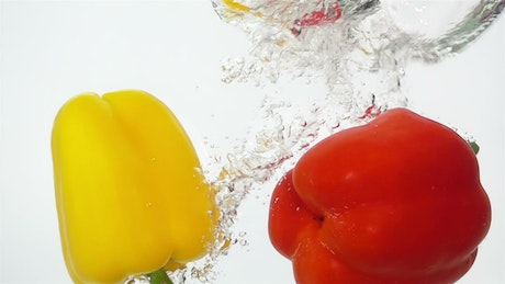 Peppers falling through water