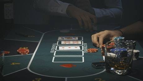 Person betting on a poker game