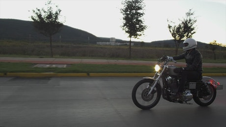 Person driving a motorcycle in the street