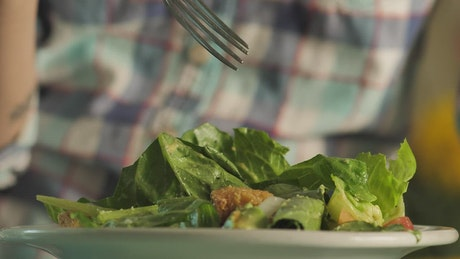 Person eating salad