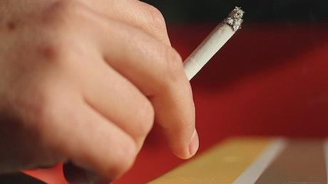 Person holding a cigarette