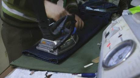 Person ironing a pants