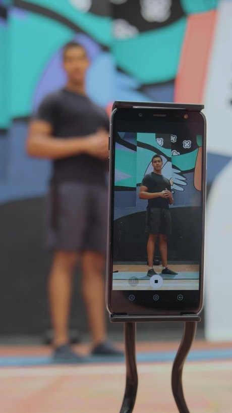 Person is filmed exercising with a cell phone