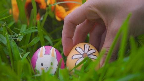 Person leaving easter eggs in garden